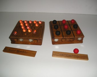 Tic-Tac-Toe/Last Marble-Last Man Out Self Storing Board Game.