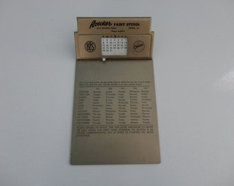 VINTAGE 1950s metal CLIPBOARD and calendar