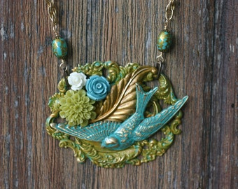 Vintage inspired blue bird collage necklace