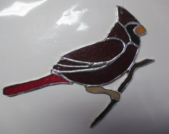 Stained glass perched Cardinal