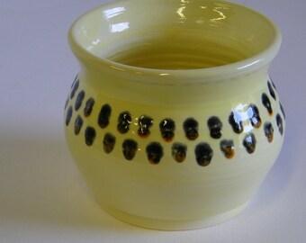 Light Yellow wheel thrown pot with Black and Orange Dot pattern