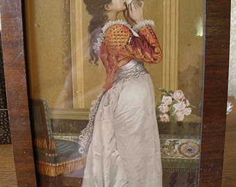 woman with letter, print,  framed under glass