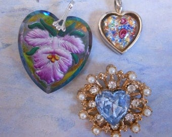 Vintage Rhinestone jewelry brooches Heart pins reverse carved pendant collection of pins three pieces