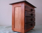 Peruvian Walnut 4 Drawer Chest has lots of storage capacity for all of your jewelry.