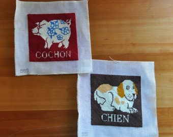 pair of cute square pig and dog needlepoints