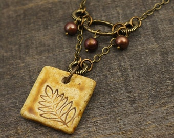SALE Fall leaf necklace, square topaz ceramic focal point, earthtones, freshwater pearls, brass chain 17 1/2 inches 48cm
