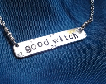 good witch, bad witch necklace in sterling silver
