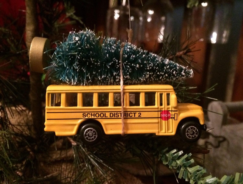 School bus carrying christmas tree ornament