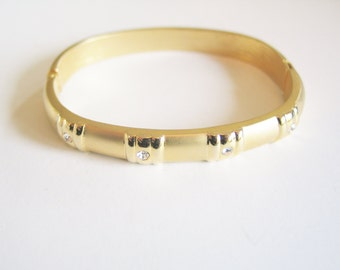 TEN DOLLAR CLEARANCE Cute, simple gold tone and brilliant cut rhinestone hinge and clip statement bracelet