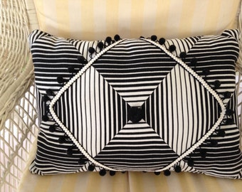 Black and white strip pillow with tassels