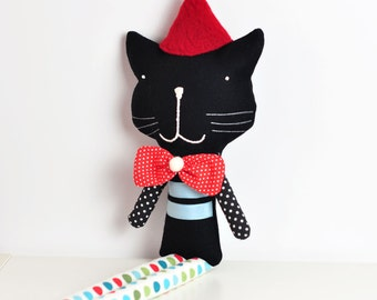 handmade soft toy cat Reinaldo - black and red with polka dot legs and red loop