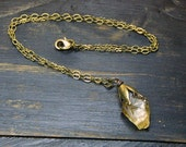 FIREFLY. Rough Raw Citrine Stone and rustic brass Victorian wing like cap necklace