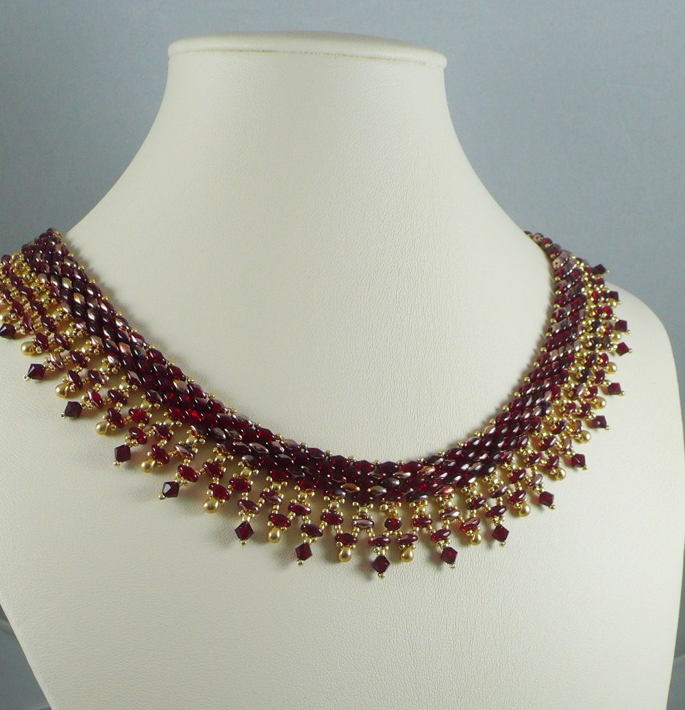 woven bead necklace and gold