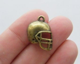 8 American football helmet charms antique bronze tone BC2