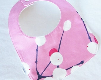 Pink Marimekko bib in Lumimarja (Snow Berry), authentic Marimekko fabric from Finland
