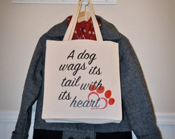 A Dog Wags its Tail Tote Bag