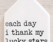 porcelain tag screenprinted text each day i thank my lucky stars for you.