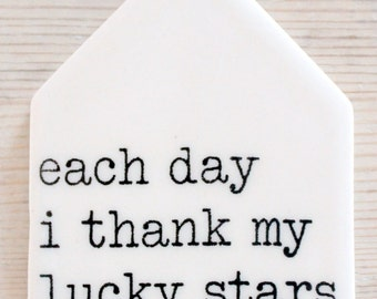 porcelain wall tag screenprinted text each day i thank my lucky stars for you.