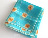 Vera Neumann Orange Flowers with White Geometric Lines on Blue Scarf