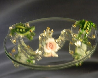 Two Frogs on lily pads wit porcelain flower