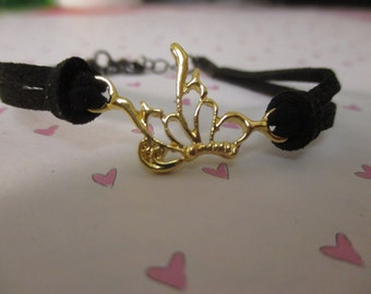 Little Golden Butterfly With A Black Faux Suede Band Bracelet