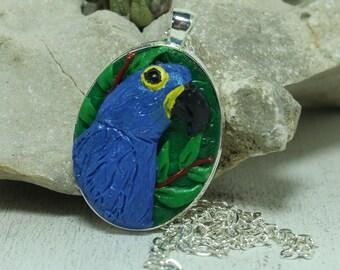 Hyacinth macaw pendant Polymer clay sculpting Bird pendant