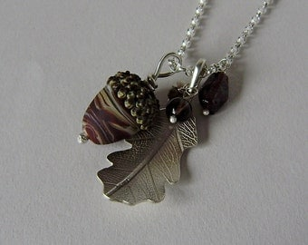 Silver oak leaf and chocolate brown glass acorn necklace