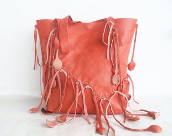 orange leather handmade handbag tote with braided straps and leaf fringe, by Tuscada. Ready to ship.