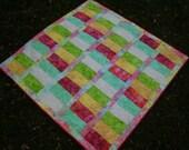 Bright baby batik quilt