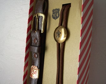 child size belt and bolo tie set - brown leather belt - string tie with fleur de lis design