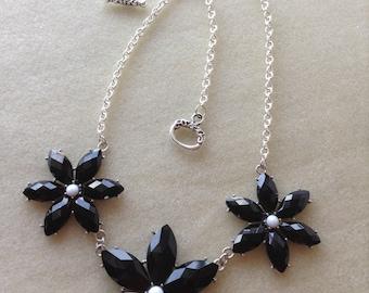 Black petal bib necklace