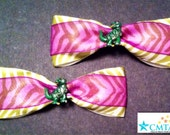 Green and purple hair bows with T-Rex buttons. Portion of sale goes to charity.