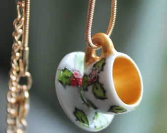 Miniature Christmas holly teacup and saucer necklace The perfect Jewellery piece for the festive season