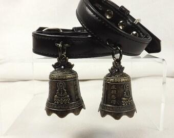 bdsm black leather wrist cuffs with large bells mature bdsm wrist restraints bondage
