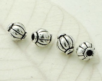 4 of 925 Sterling Silve  Drum Beads 5x5.5 mm. :th2166
