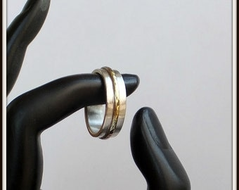 Handmade sterling silver and bronze wedding band, brushed finish. Promise ring or everyday wear.