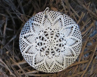 10 inch Delicate eye-catching crochet window or wall hanging with a small crystal