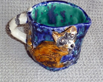 Sweet little raccoon pitcher handmade in the U.S. sold by Outsider Artist