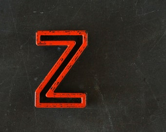 "Vintage Industrial Letter ""Z"" Black with Orange and Blue Paint, 2"" tall (c.1940s) - Monogram Display, Shadow Box Letter, Art Supply"