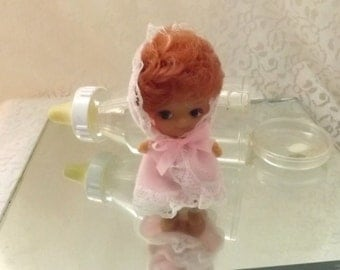 miniature red head baby doll with b ottle red hair baby doll in