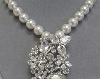 Statement bridal necklace with 12mm white Swarovski pearls and rhinestone pendant.