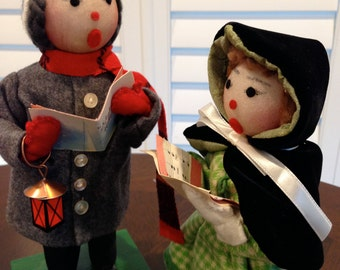 Pair of vintage handcrafted carolers figurine holding the words to silent night christmas