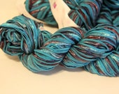 The Gourmet collection: Sea jewels Tartlette yarn, teal ribbon yarn, variegated, knit one crochet too