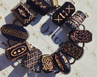 Antique Button Bracelet, Black glass, gold trim, 'coffin' style