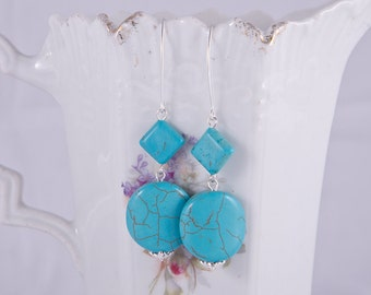 Elegant long sterling silver earrings with beautiful blue howlite turquoise stones, sterling silver spirals, marquis hooks, december stone