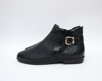 Vintage black leather 90s women flat ankle boots with golden buckle / ankle boots shoes