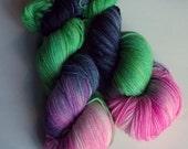Scarah on Nub 100% SW Merino Hand dyed fingering weight sock yarn