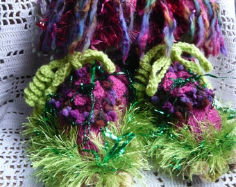 Handknitted woman fairy slippers psychedelic fall wine colors dark pink rasberry purple blackcurrant flowers green grass twisted vegetal
