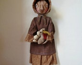 Primitive Pioneer Doll holding Turkey