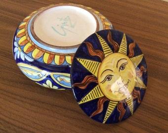 Handpainted Ceramic box with floral and sun design. 15 cm diameter